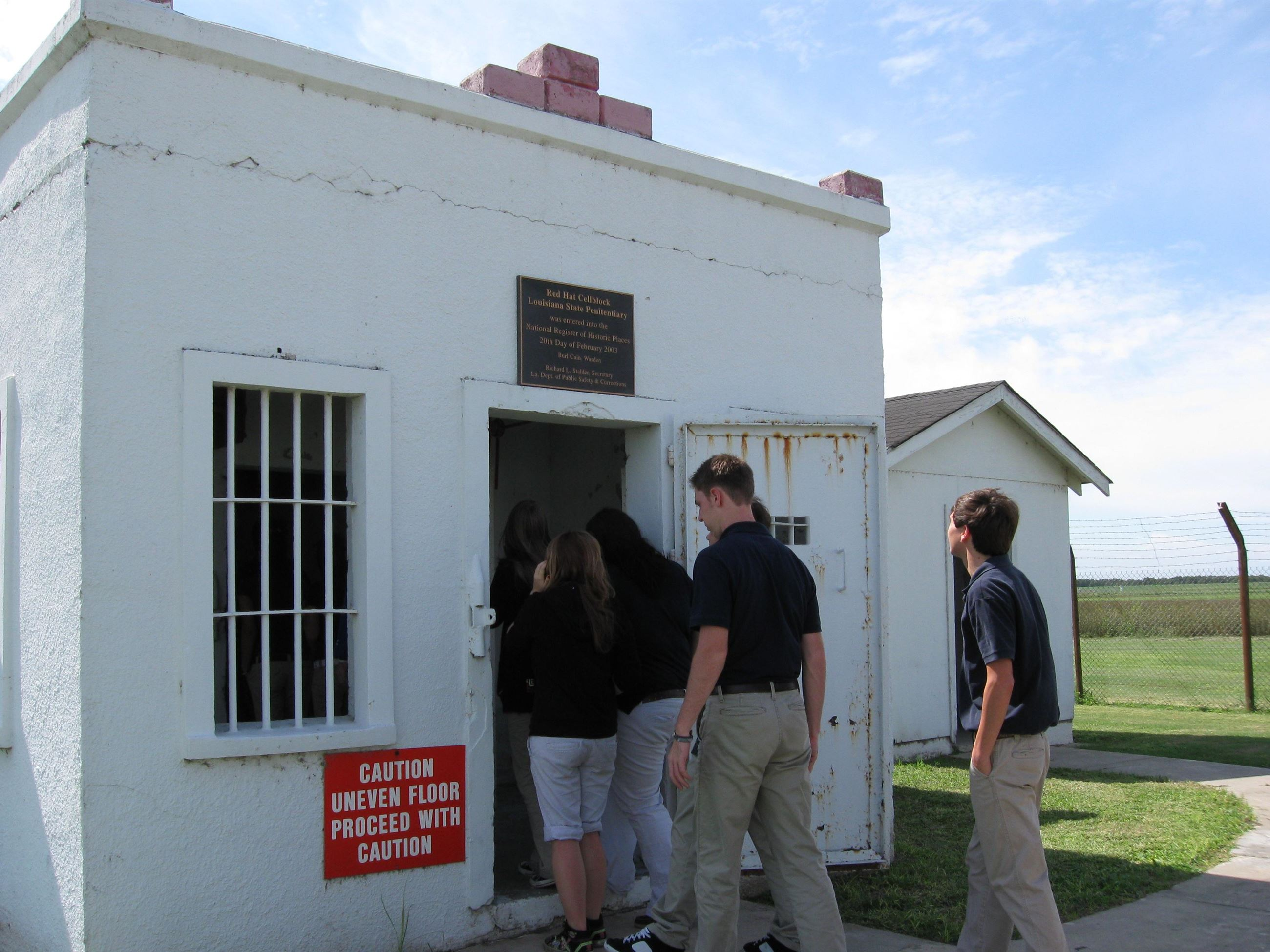 Students Entering a Small Building